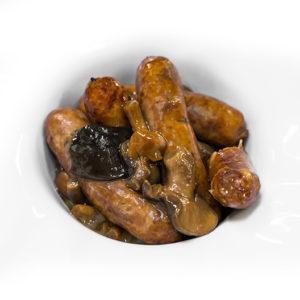 Mini salchichas de cerdo ibérico con setas y salsa Pedro Ximénez